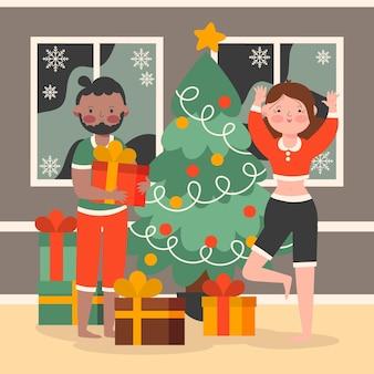 Adultos desempacando sus regalos de navidad