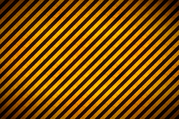 Advertencia de rayas amarillas y negras con textura grunge, fondo industrial