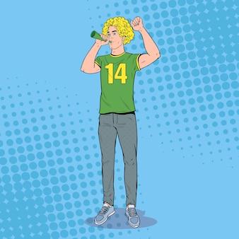 Aficionado al fútbol pop art man con cuerno apoyando a su equipo favorito