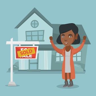 Agente inmobiliario africano con cartel vendido.