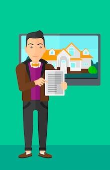 Agente inmobiliario que ofrece casa.