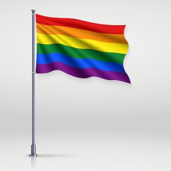 Agitando la cinta con la bandera del orgullo lgbt.