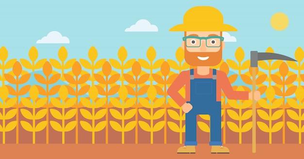 Agricultor en el campo con guadaña.