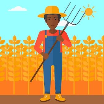 Agricultor con horca.