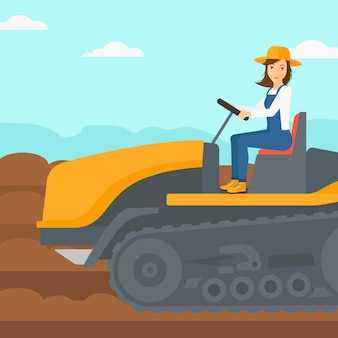Agricultor manejando el tractor.