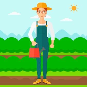 Agricultor con regadera.