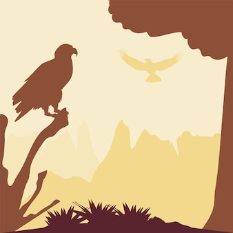Águila silueta en rama