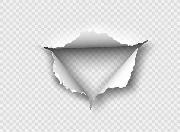 Agujero irregular rasgado en papel rasgado en el fondo