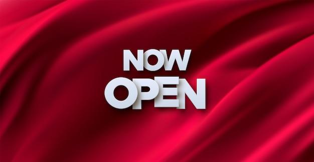 Ahora abierto letrero blanco en banner de tela roja