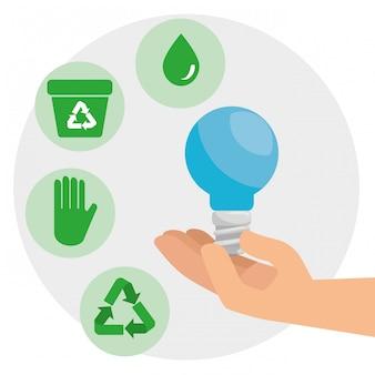 Ahorre bombilla en las manos para la conservación del medio ambiente.