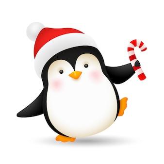 Alegre bebé pingüino bailando con bastón de caramelo