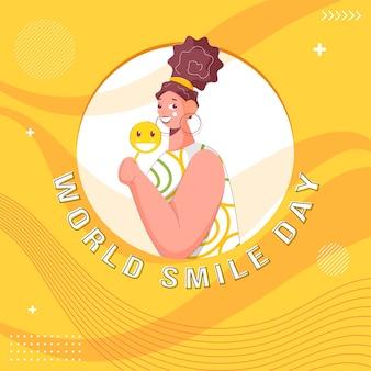 Alegre joven sosteniendo smiley stick o lollipop sobre fondo amarillo onda abstracta para el día mundial de la sonrisa.