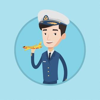 Alegre piloto de línea aérea con modelo de avión.