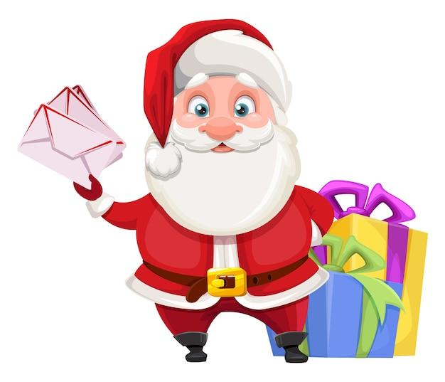 Alegre santa claus preparando regalos para niños