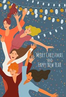 Alegres sonrientes saltando chicas en una fiesta corporativa en el fondo de guirnaldas festivas