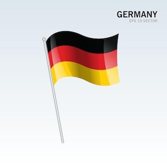 Alemania ondeando la bandera aislada sobre fondo gris