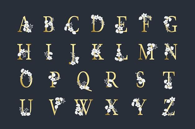 Alfabeto dorado con flores elegantes