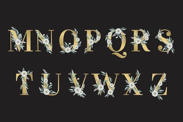Alfabeto dorado con hojas y flores.
