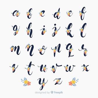 Alfabeto floral en diseño plano