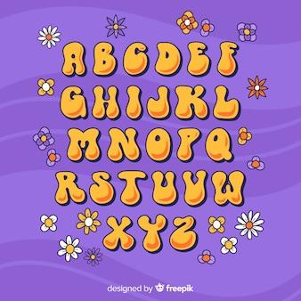 Alfabeto floral en estilo años 60 en diseño plano