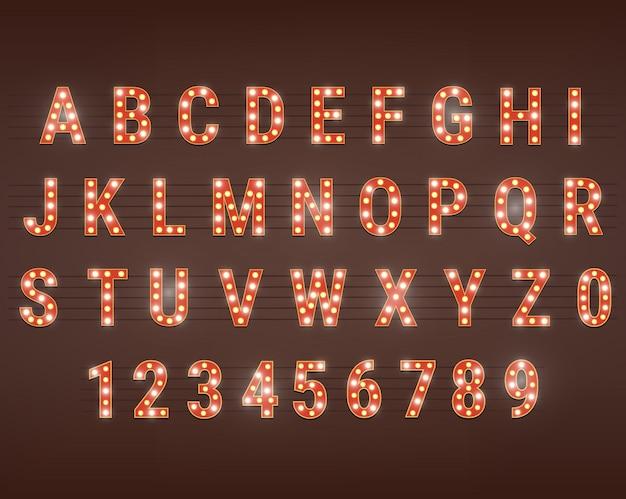 Alfabeto de fuente retro con bombillas brillantes