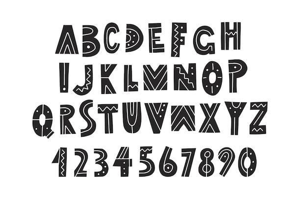 Alfabeto, letras y números dibujados a mano sobre fondo de pizarra