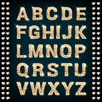 Alfabeto de oro con diamantes en forma de corazón.