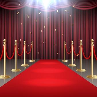 Alfombra roja, cortina y cuerda de barrera en resplandor de focos.