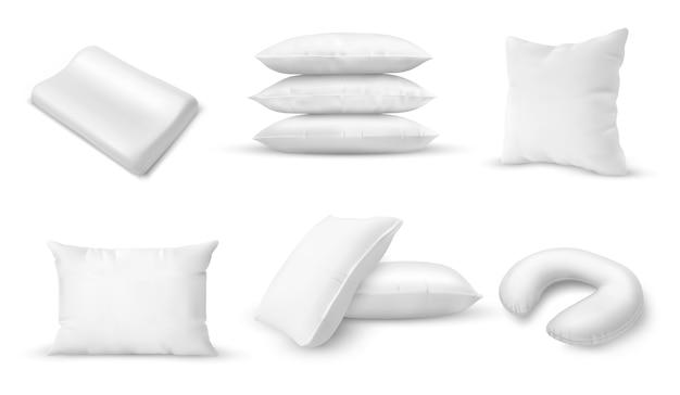 Almohadas blancas de diferentes formas.