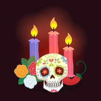 Altar del día de los muertos con velas encendidas, calavera de colores decorada con flores de caléndula