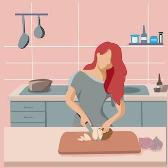 Ama de casa de la mujer que prepara la comida en la cocina.