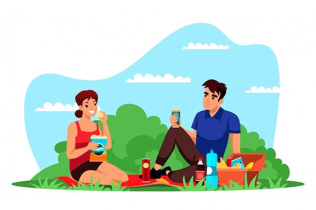 Amante hombre y mujer descansan en picnic en la naturaleza