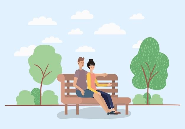Amantes de la joven pareja sentada en la silla del parque