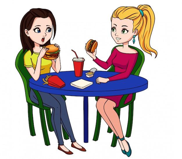 Amigas comiendo comida rápida en el restaurante.