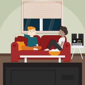 Amigos comiendo palomitas de maíz y viendo televisión