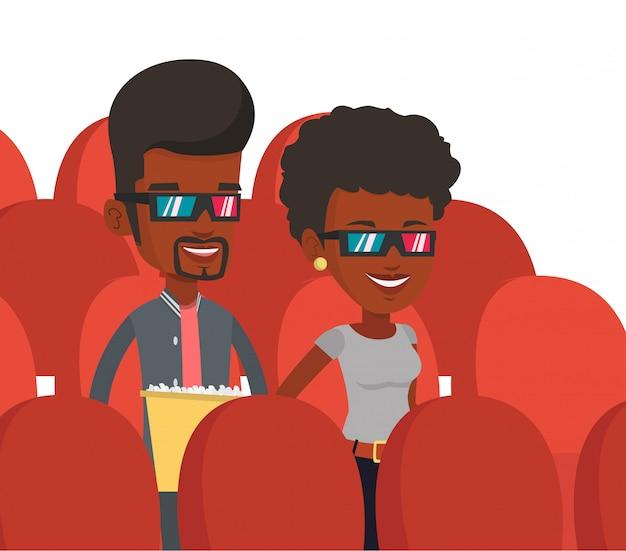 Amigos felices viendo películas en 3d en el teatro.