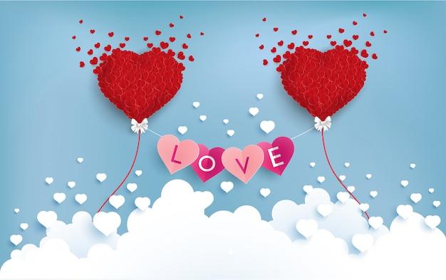 Amor y globo sobre las nubes