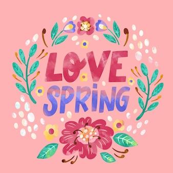 Amor letras de primavera con flores y hojas.