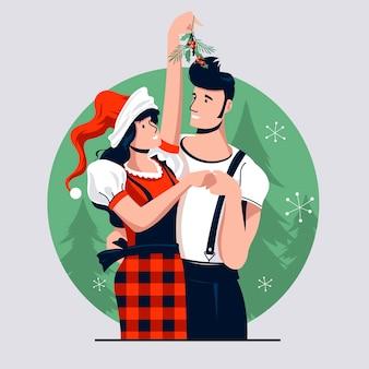 Amor pareja besándose bajo el muérdago durante las vacaciones de navidad celebrar