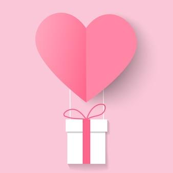 Amor y san valentín con globo de corazón y caja de regalo