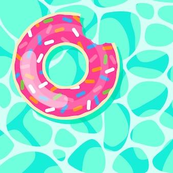 Anillo de natación de rosquilla rosa flotando en el fondo del agua