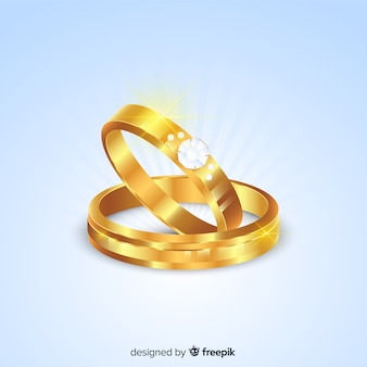 Anillos de boda dorados en estilo realista