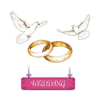Anillos de boda y palomas