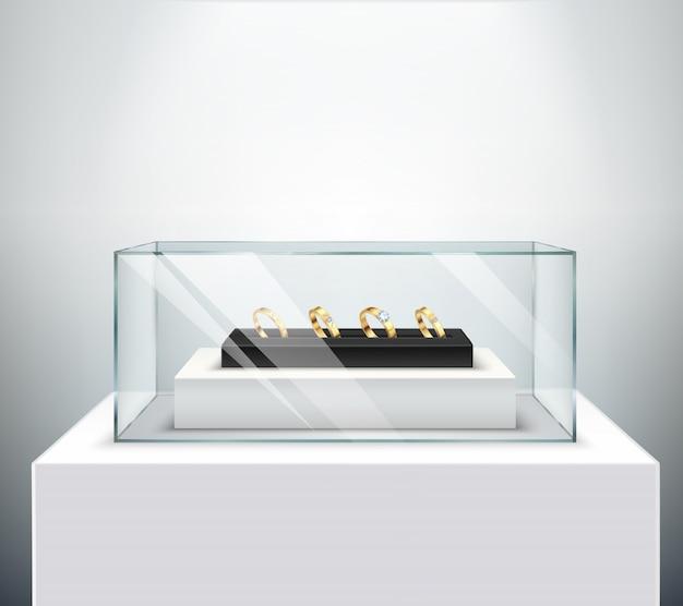 Los anillos de bodas de compromiso de diamantes exclusivos de oro se exhiben en vidrio expositor de lujo