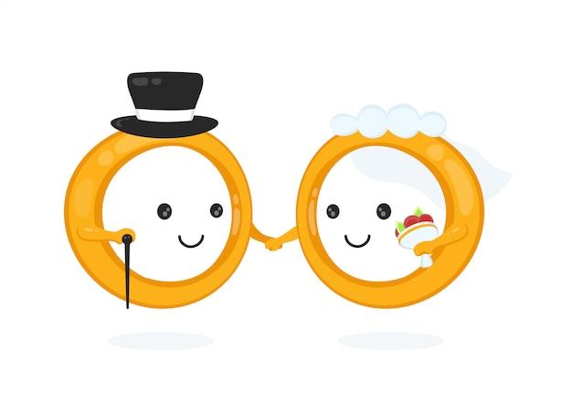 Anillos sonrientes felices de la boda