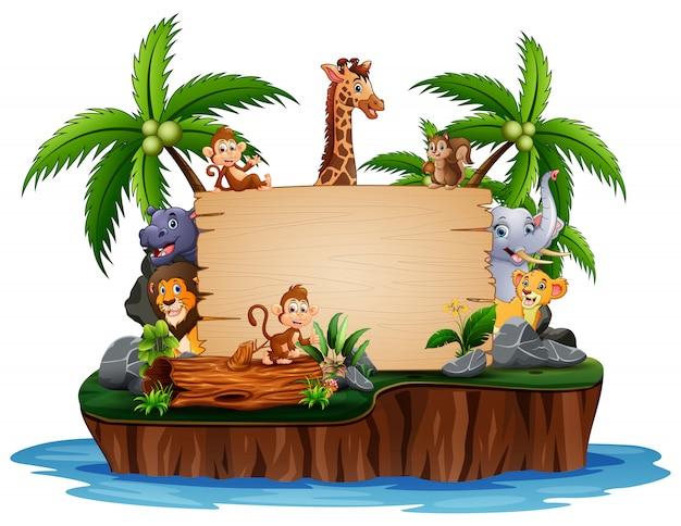 Animales salvajes con cartel de madera en la isla
