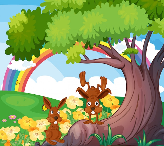 Animales salvajes juguetones bajo el gran árbol.