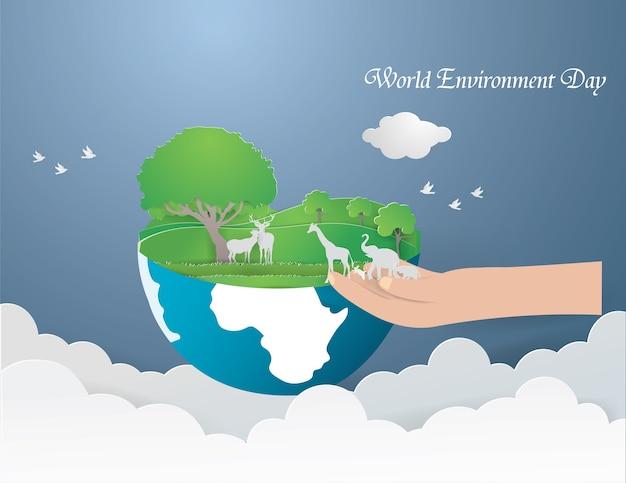 Los animales salvajes en la mano van a la tierra verde