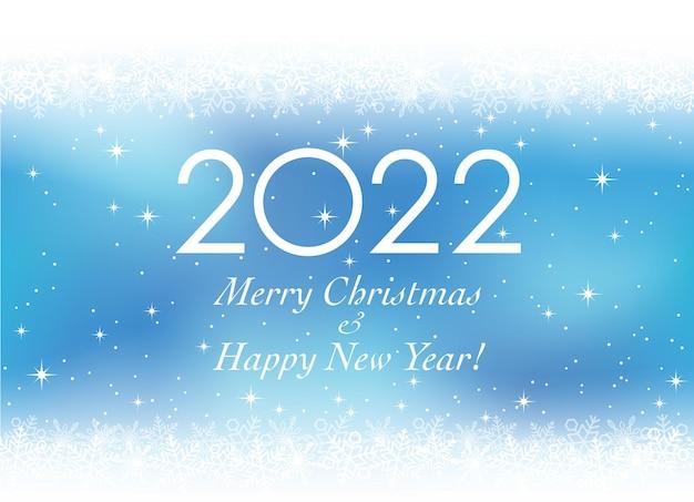 El año 2022 navidad y año nuevo tarjeta de felicitación de vector con copos de nieve sobre un fondo azul.