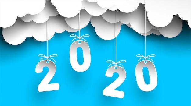 Año nuevo 2020 en el cielo con número de nubes en papel cortado y estilo artesanal para sus volantes, saludos y tarjetas de invitaciones.